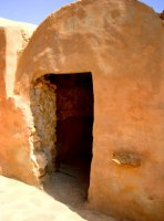 The individual barrel-vaulted ghorfas were used to store grains for the berber families of the village.