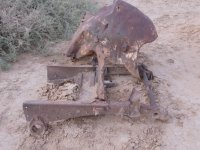 Remains of the front of an old truck or car.