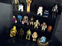 The figure on the bottom shelf on the left is one of the all-time most rare figures...